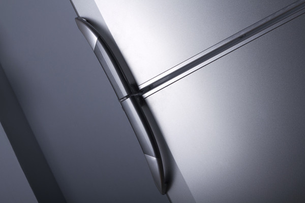 Closeup of stainless steel refrigerator and freezer